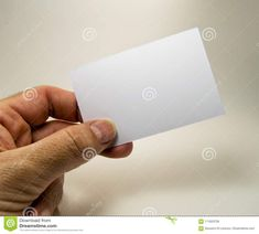 Photo about White empty card with a man hand, for free text, on a gray background. Image of sign, card, gray - 111833756