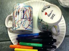 Easy Christmas gifts for Kids to make for Their Parents or their Grandparents. Just color On Coffee Mugs with sharpies and Bake at 350 for 30 min. So fun!!!