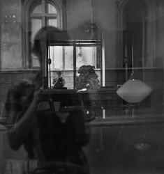 Vivian Maier – mirror self portraits. She is bothe in the mirror and in the window reflection.
