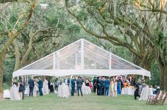 Tent set up under the oaks for a Legare Waring House wedding - Aaron and Jillian Photography