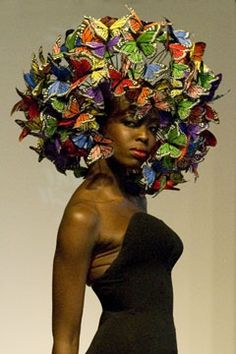 Millions of butterflies descend upon this fierce black lady's head and coalesce to form a hat.