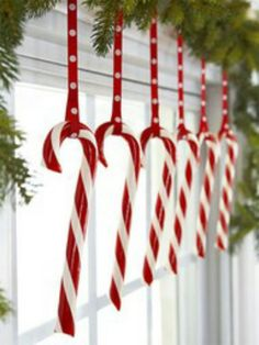 i'm doing this next christmas- in the dining room! Candy Pane Hooked onto polka-dot ribbons, a row of candy canes livens up a bough-decked window. Read more: Red and White Christmas Decorations - Red Christmas Decorating Ideas - Good Housekeeping Noel Christmas, Merry Little Christmas, Christmas Projects, Winter Christmas, Christmas Windows, Christmas Candy, Christmas Christmas, Christmas Window Decorations, Winter Decorations