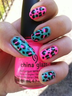 Neon blue and pink animal print nails by Tuuuba-Girl