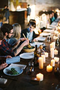 {a wooden table, food, friends, and candles for days via Kinfolk Magazine - Gallery - Brooklyn, New York}
