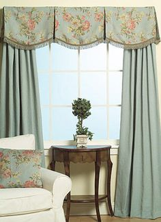 box pleated, scalloped floral valance with light blue drapery panels.  terrific for bedroom, traditional decorating