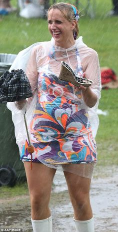 Go Go gone: One punter in Go Go boots and a poncho laughed as she clutched a discarded broken wedge shoe Melbourne Races, Melbourne Cup, Oaks Day, Ladies Day, Wedge Shoes, Derby, Racing, Lady, Boots