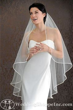Fingertip veil with a simple edge to complement your wedding dress