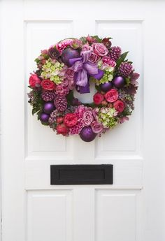 This modern Christmas wreath will make a cheery sight all through the festive period.