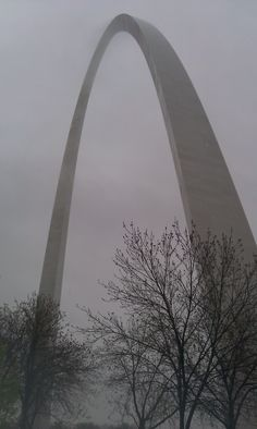 St. Louis Arch - photo by Nicole Moran. This is where me and Bryan went minutes after finding out I was pregnant. And it was stormy too. Oh the memories.