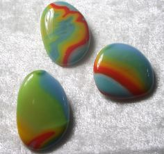 Thses stones are from a stack of 5 colors of glass fused together, then pieces are nipped off and re-fused to make individual cabs.  Love this technique.