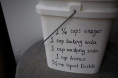 This is like the basic homemade laundry detergent recipe.  However, this one uses liquid castile soap instead of bar and you put vinegar in the mix!!  I like the use of Castile natural organic soap!!
