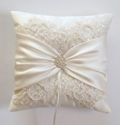 This will be the pillow for the ring bearer to carry that matches the flower girl's beautiful lace and satin basket. It will also be white instead of ivory.
