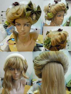 Gibson girl hair http://media-cache-ak0.pinimg.com/originals/69/04/60/6904605a5da87b047e086f4c7f92074b.jpg