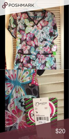 Peaches butterfly scrub top size medium (NWT) Sheer butterflies print.  Black with hot pink& turquoise. 2 front pockets. 2 side vents.  Side medium peaches Other