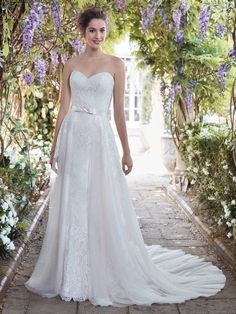 Romantic allover lace contrasts beautifully against Ava Satin in this classic sheath wedding dress, featuring a strapless sweetheart neckline and illusion scoop back accented in soft lace. Finished with covered buttons and zipper closure. Includes the detachable tulle overskirt with Ava Satin bow waistband. #weddingdress #bridalgown #rebeccaingram #sheath #lace #atlasbridalshop #weddinggown Colored Wedding Dresses, Best Wedding Dresses, Bridal Dresses, Wedding Gowns, Bridesmaid Dresses, Wedding Outfits, Bridal Gown, Boho Wedding, Older Bride