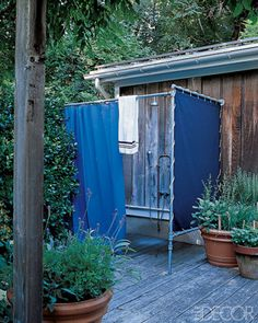 In Sarah Jessica Parker and Matthew Broderick's Bridgehampton home, a marine tarp on a frame turns a corner of the deck into an outdoor shower.    - ELLEDecor.com