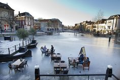 Frozen canals, with seating(!), in Leiden, Netherlands