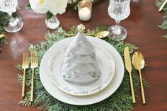 Try different types of napkin folding! Dress up your holiday tablesetting with this easy Christmas Tree Napkin Fold Tutorial. Video tutorial included.