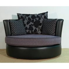 A cuddle chair.  You can't even believe how comfortable these are till you've actually sat in one.