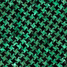 A houndstooth checked pattern using black marble and green marble.