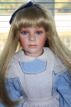 Alice in Wonderland by Thelma Resch. Big porcelain doll.