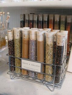 Who says test tubes have to stay in the lab? Since kitchens are pretty much the home's experiment center, we think these little glass containers are just as appropriate for your various flavors of salt. Click through for more on this and other ways to organize your spices.