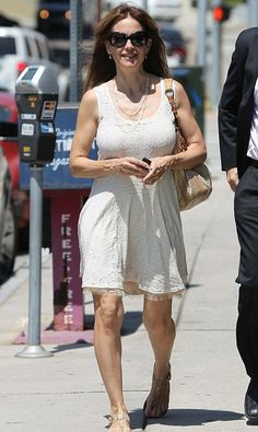 Kelly Preston Shows Off Her Legs In Her Sundress - It is rare to find someone in Hollywood to age gracefully and it looks like Kelly Preston is one of those actresses that can do so. The wife of John Travolta looks beautiful in her dress that sh Gal Gabot, Kelly Preston, John Travolta, Aging Gracefully, Celebs, Celebrities, In Hollywood, Lace Skirt, White Dress