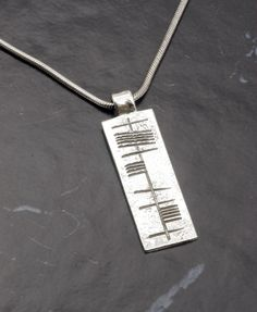 """Sterling silver Ogham Pendant The script is an ancient script the Script reads in Irish """"Anam Cara"""" Soul mate Pendant size x Irish Font, Ancient Scripts, Celtic, Arrow Necklace, Silver Jewelry, Handmade Jewelry, Sterling Silver, Personalized Items, Pendant"""