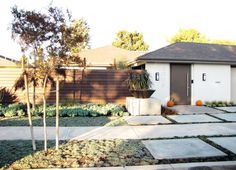 midcentury exterior by Tara Bussema - Neat Organization and Design
