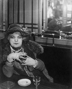 "George Brassaï (pseudonym of Gyula Halász), "" La Môme Bijou"" of the Montmartre cabarets, from ""Paris by Night"", 1933."