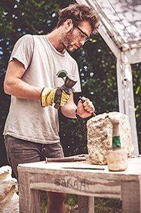 Stonecarving outdoors, with Dartmoor Arts summer school, stonemasonry workshop for young people 7-8 may 2016