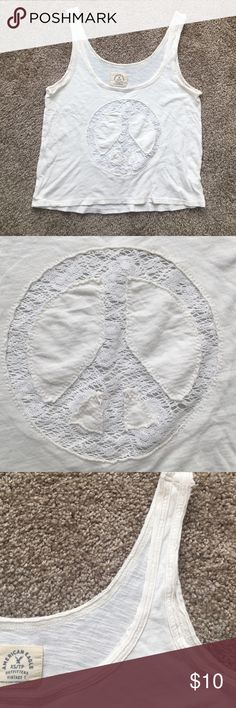 AE top Light cream colored top with peace sign. NO TRADES American Eagle Outfitters Tops