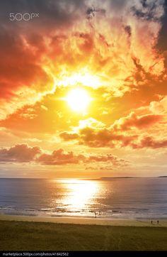Sunset - title Tourists walking on Ballybunion beach in Ireland. - by David Morrison