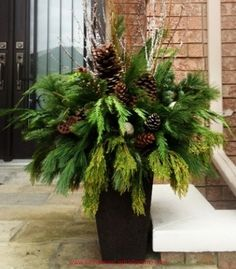 56 Excellent Christmas Wearth Decoration For Your Door. Flowers play a significant role in Christmas decorations, all over the world. People decorate their homes and work places with a variety . Exterior Christmas Lights, Christmas Urns, Christmas Flowers, Green Christmas, Winter Christmas, Christmas Wreaths, Christmas Ornaments, Handmade Christmas Decorations, Xmas Decorations