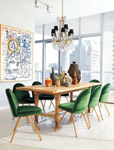 Green dining chairs + chandelier