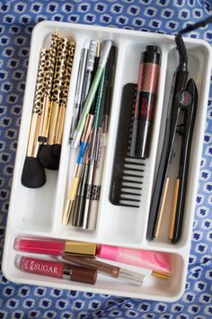 Kitchen utensil organizers are just as useful when tucked into drawers in your bathroom or vanity — just replace the knives with a straight iron, the forks with makeup brushes, and the spoons with eye liners. Click through for more on this and other ways to organize your beauty products.