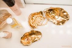 Here's a fresh reason to savor an oyster: with a fresh coat of gold spray paint, their shells become the prettiest of catch-alls (just be sure to wash and dry them carefully first!) Apply the same technique to other shells around the house for a similar look.