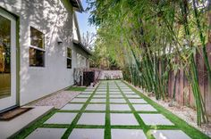 Gray concrete paver step walkway in backyard