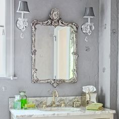 A silvery color palette, mirrored surfaces, and crystal accents add sparkle to this Hollywood Regency-style bathroom. | Photo: Evan Sklar  | See the entire bath @ thisoldhouse.com