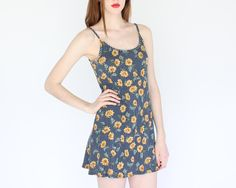 vintage 90s sleeveless sunflower mini dress / grunge summer floral flower dress. $42.00, via Etsy.