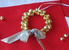 Jingle Bell Wreath Craft: Christmas Crafts for Kids - Kaboose.com