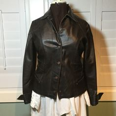 Distressed brown faux leather jacket Super cute and comphy, it's  got a lot of stretch. The distressed look is perfect for the casual layered look. Cute pink rivets on pockets, lots of details! This is a Jr fit, so the fit would be a generous large for a women's cut. Great condition, worn only a couple times. Jackets & Coats Blazers