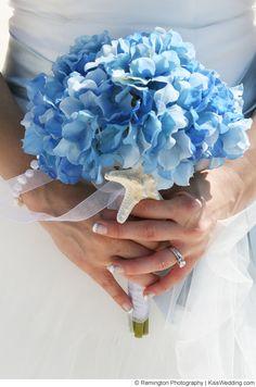 beach wedding bouquet with blue hydrangeas and a starfish.