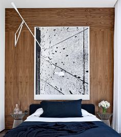 A graphic Adam McEwen work draws the eye in this guest bedroom at @arod's Florida home. Photo by @bjornwallander by archdigest