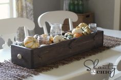 Love this easy fall tablescape. Candles in mason jars with gourds & pumpkins #table #fall