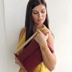 Amazing red clutch and gold bracelet on #SummerAddicts