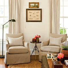 Classic: Slipcovered Lee chairs, striped panels, jute rug, and apothecary floor lamp... never goes out of style