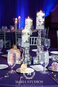 Glass Candle holders with floating candles and submerged florals atop silver candlesticks created an striking centerpiece. Small Centerpieces, Silver Candlesticks, Wedding Consultant, Set Up An Appointment, Floating Candles, Glass Candle Holders, Event Design, Wedding Details, Wedding Inspiration