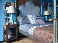 John Robshaw's Apartment. NYC apartment. Bedroom. Striped upholstered headboard, turquoise double gourd lamp