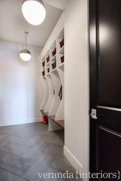 Mudroom- Loving the herringbone tile designed by veranda interiors Room Tiles, Bathroom Floor Tiles, Tile Floor, Calgary, Veranda Interiors, Mudroom Laundry Room, Grey Shelves, Tall Shelves, Herringbone Tile